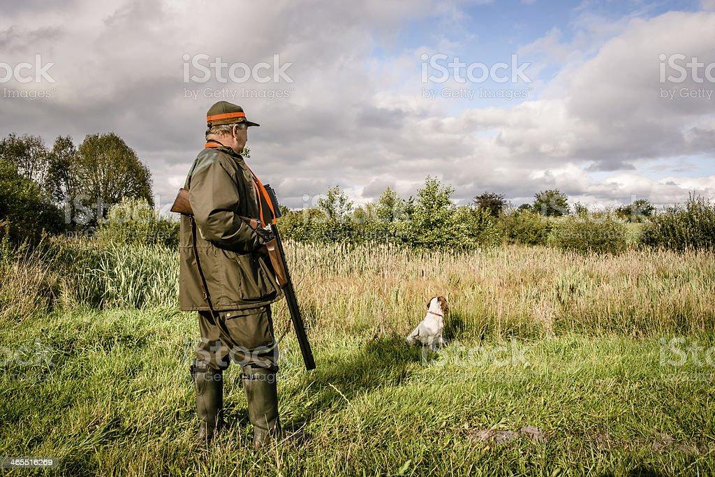 Hunter standing stock photo