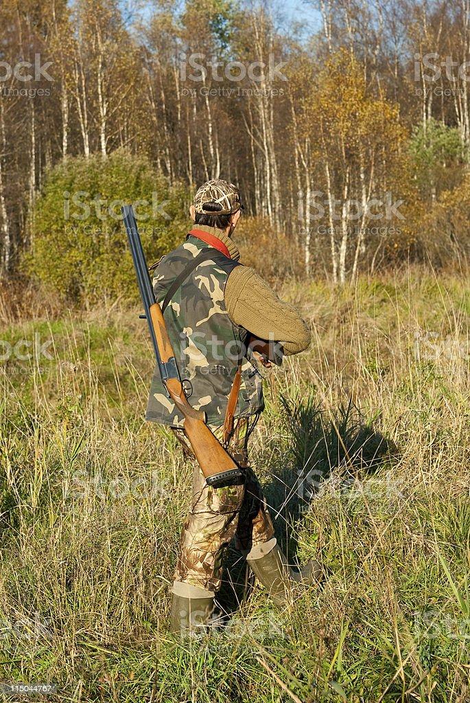 Hunter walking royalty-free stock photo