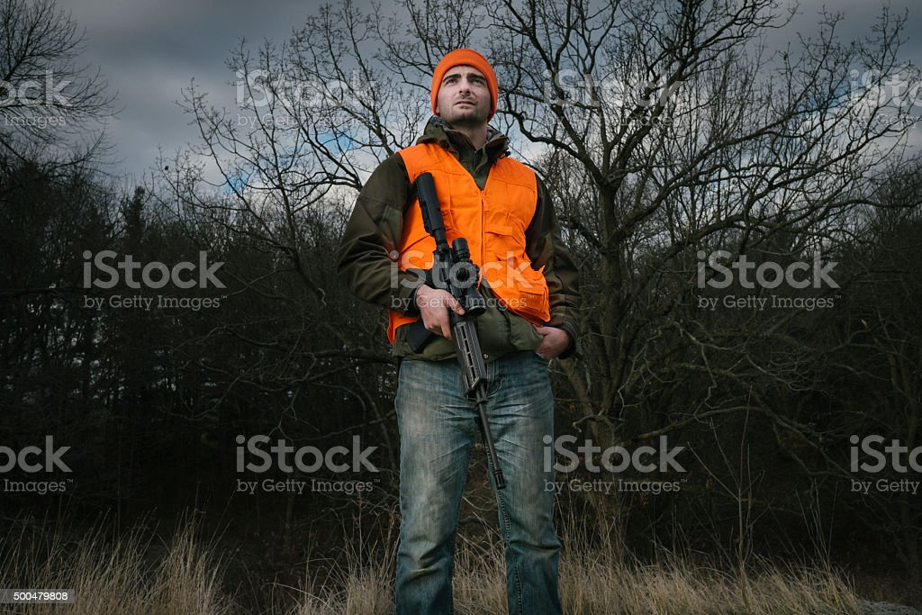 Hunter with a rifle stock photo
