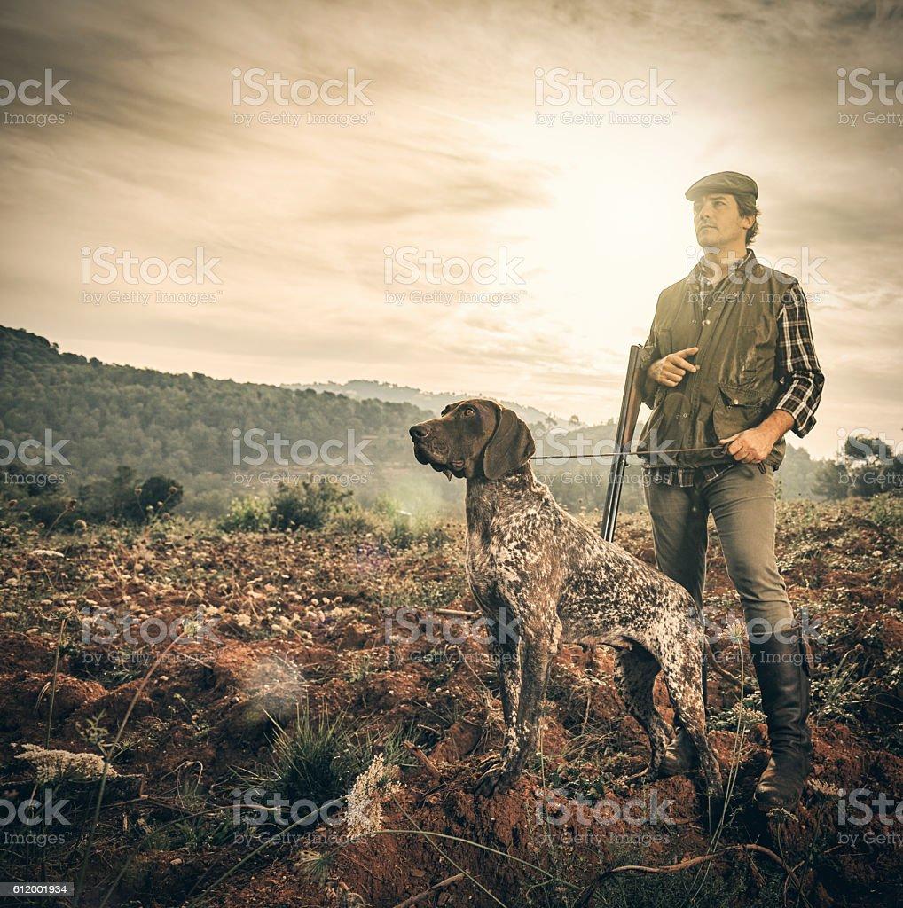 Hunter with dog stock photo