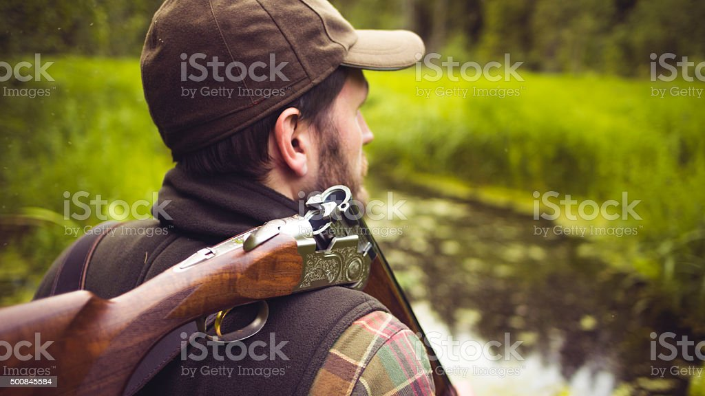 Hunter With Open Shotgun On Shoulder stock photo