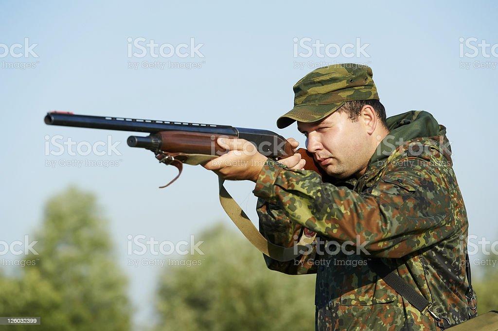 hunter with rifle gun royalty-free stock photo