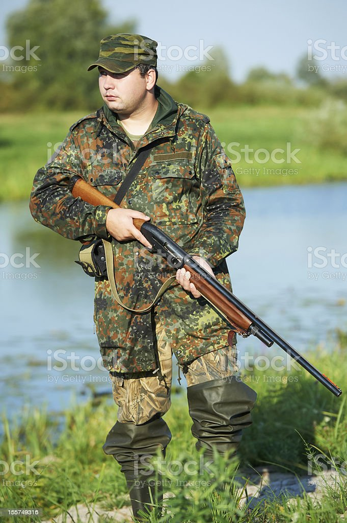 hunter with rifle gun royalty-free stock photo