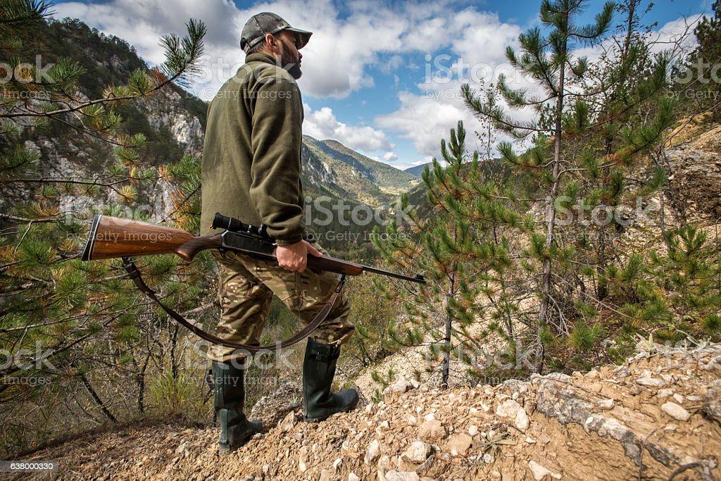 Hunter with rifle stock photo
