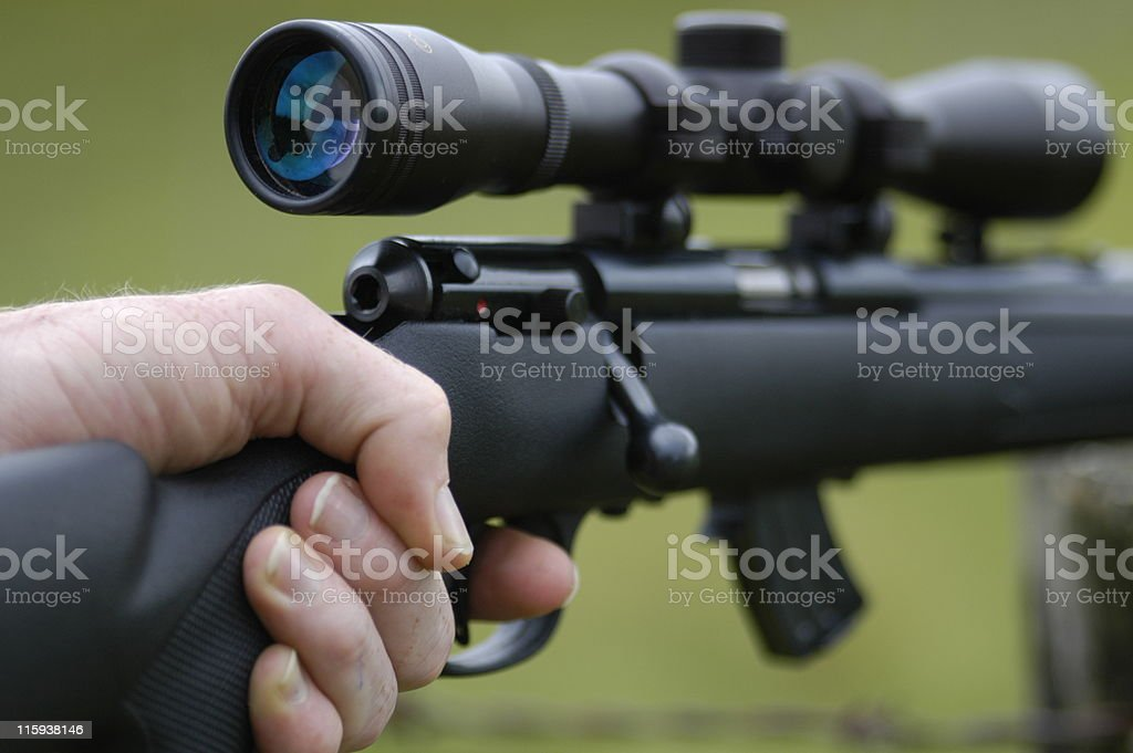 Hunters finger on the trigger. stock photo