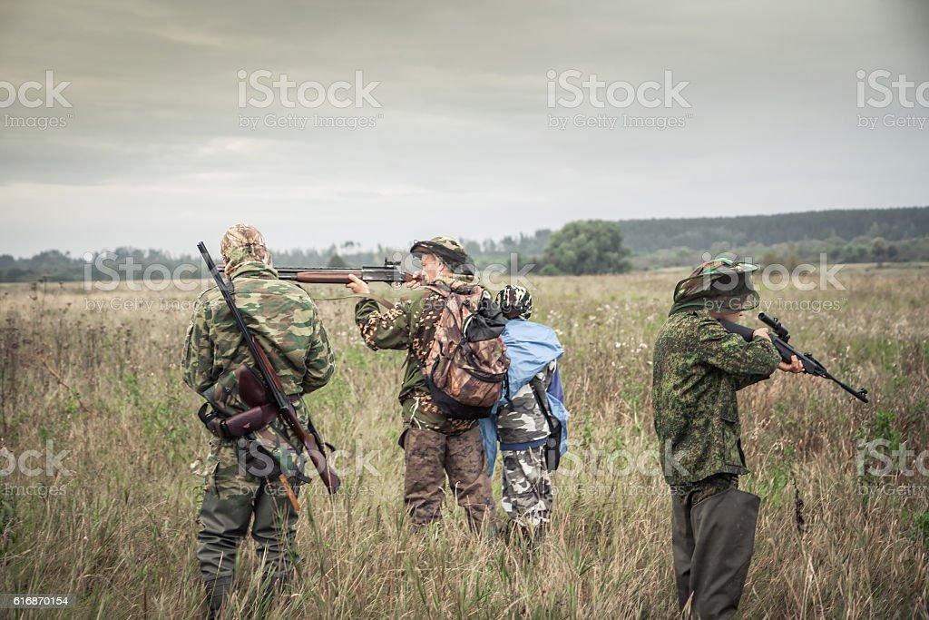 Hunters preparing for hunting in rural field in overcast day stock photo