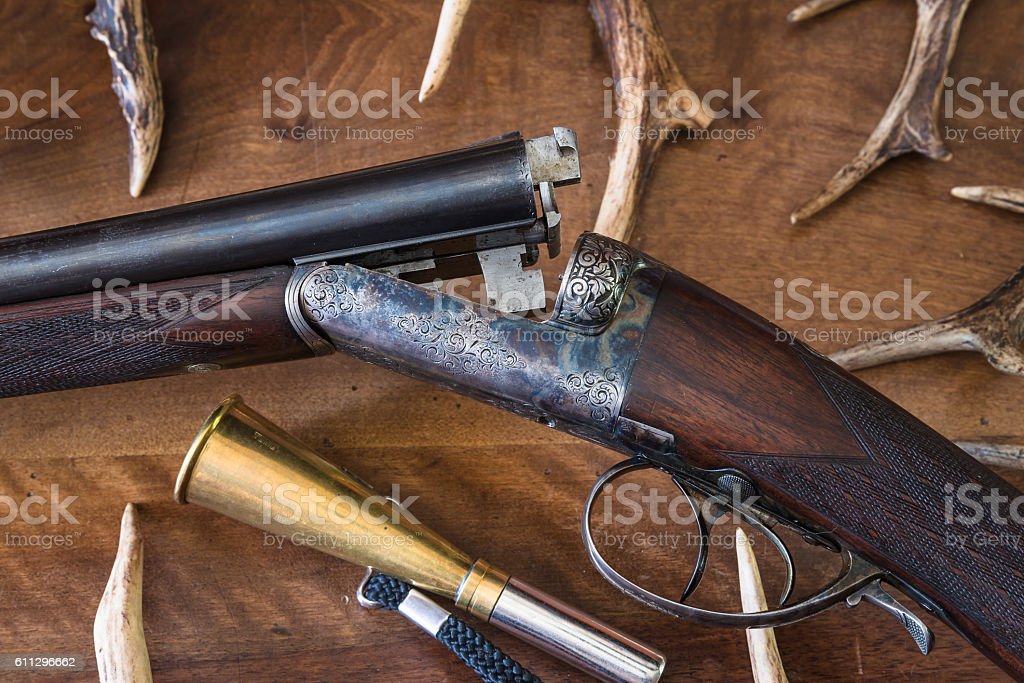 Hunting gun and antlers stock photo