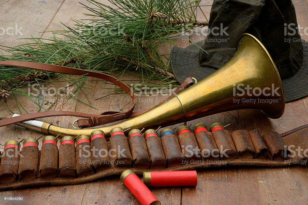 Hunting horn and belt with slleeves stock photo