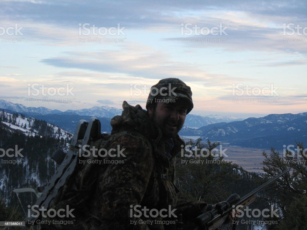 Hunting in the snowy mountains stock photo
