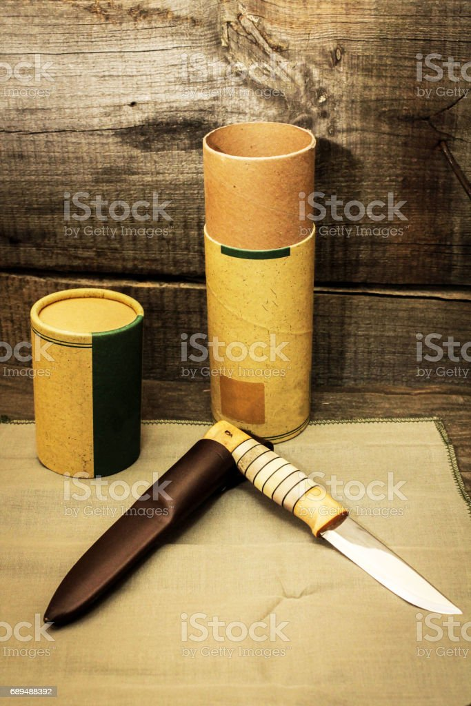 Hunting knife in a gift tube. A gift to the hunter. Gift for a man. stock photo