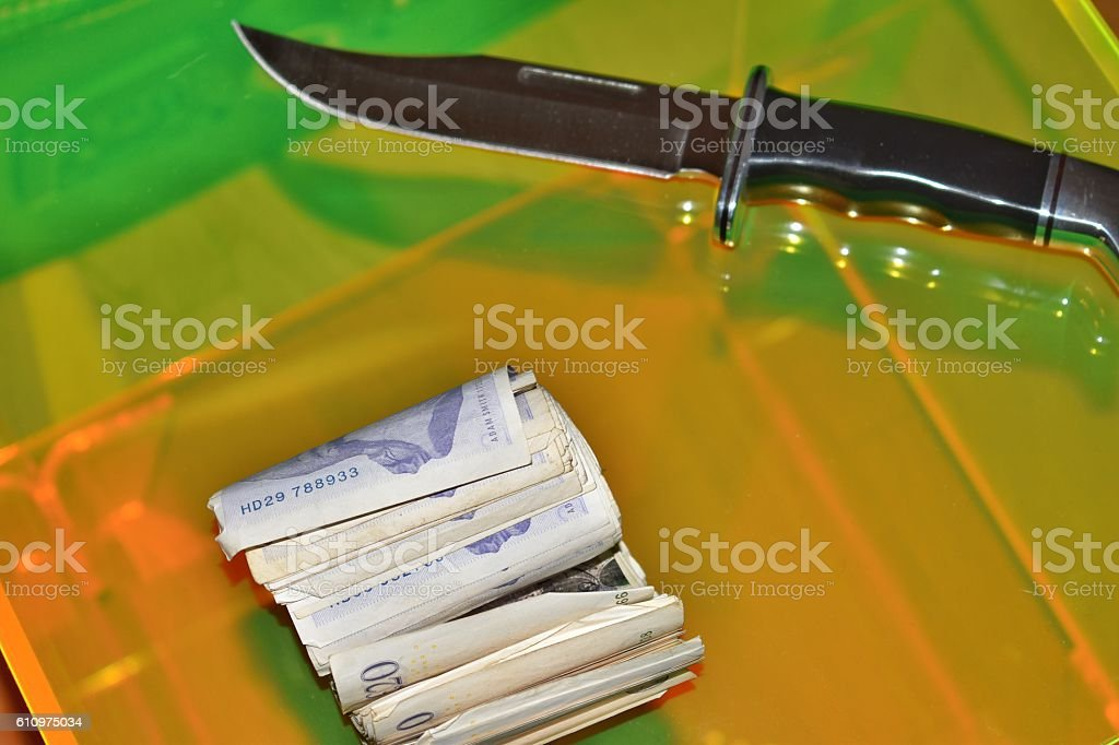 Hunting knife on table with moneY close up stock photo
