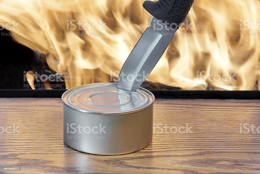 Hunting Knife opening a canned food stock photo