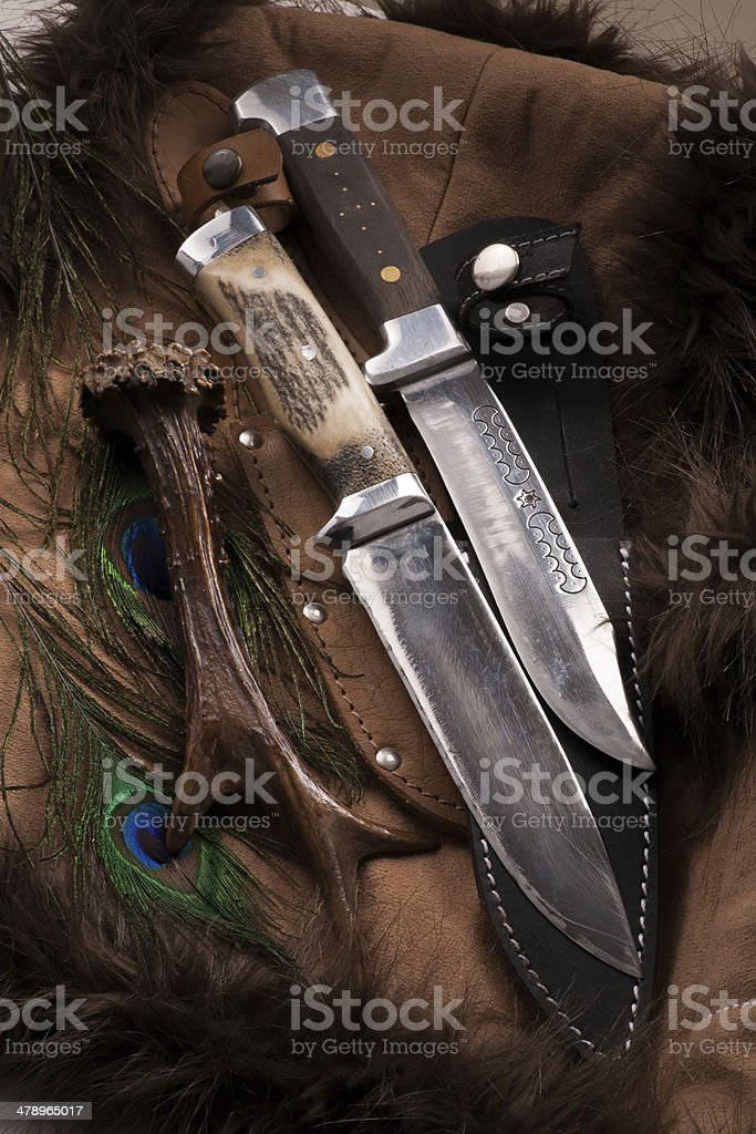 Hunting knives on dark background - group objects stock photo