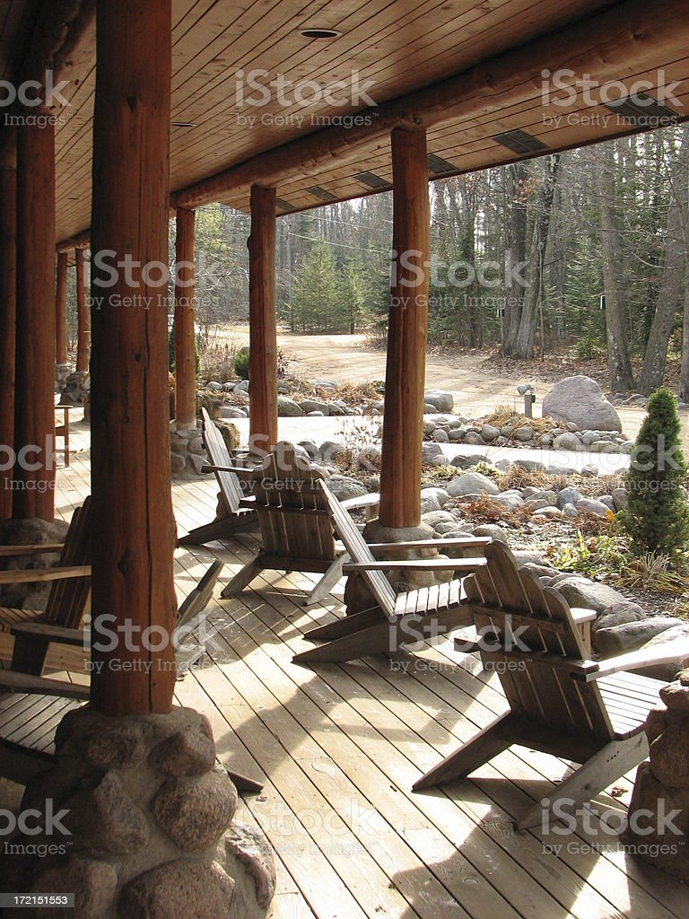 Hunting Lodge Deck Adirondack Chairs royalty-free stock photo