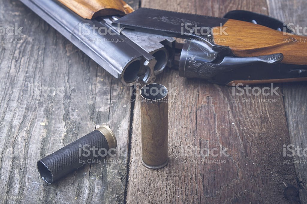 Hunting rifle on a wooden background stock photo