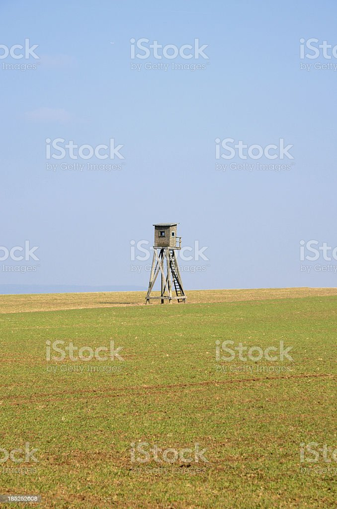 Hunting stand in field under clear sky royalty-free stock photo