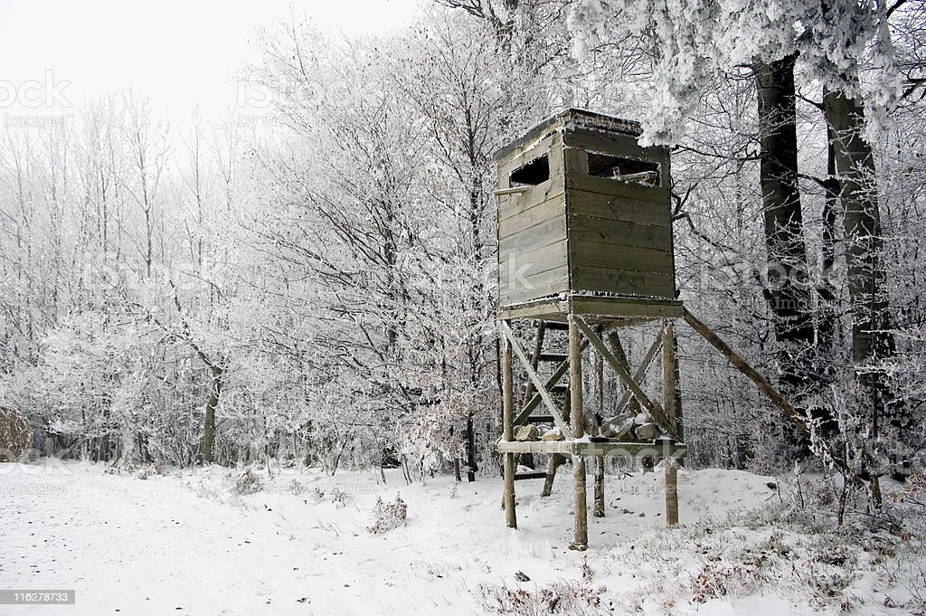 Hunting Tower in Winter Landscape royalty-free stock photo