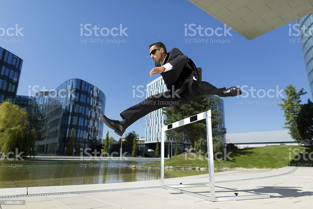 hurdler in business suit stock photo