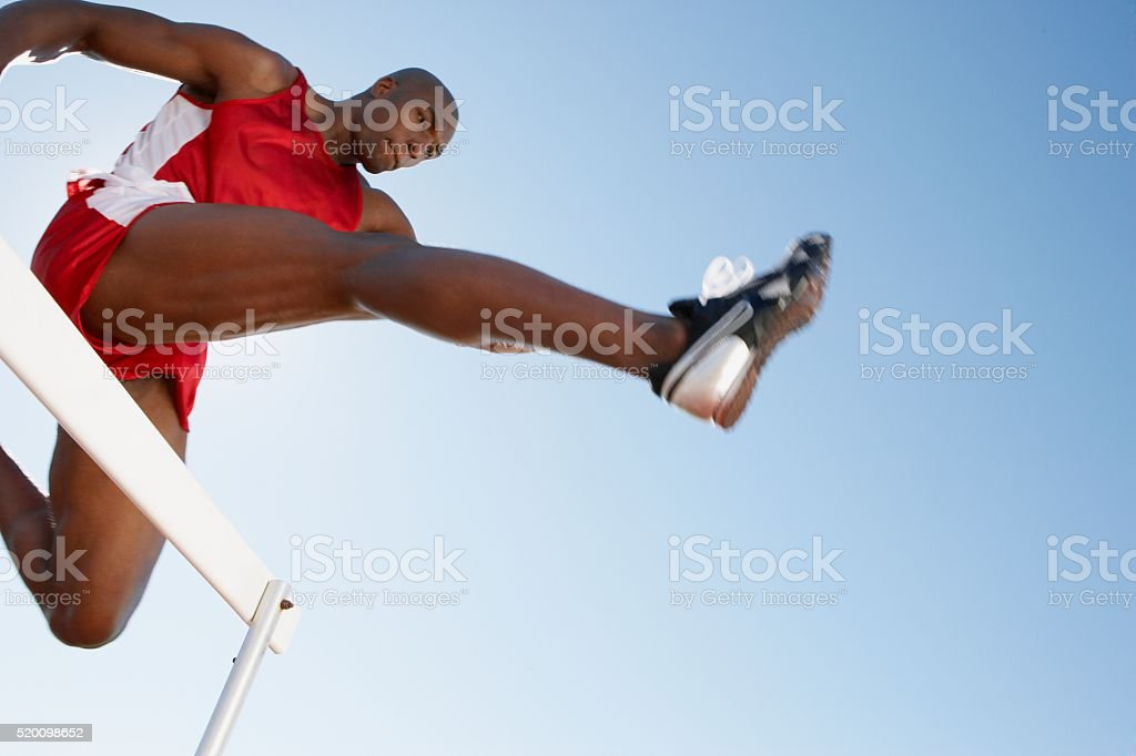 Hurdler jumping stock photo