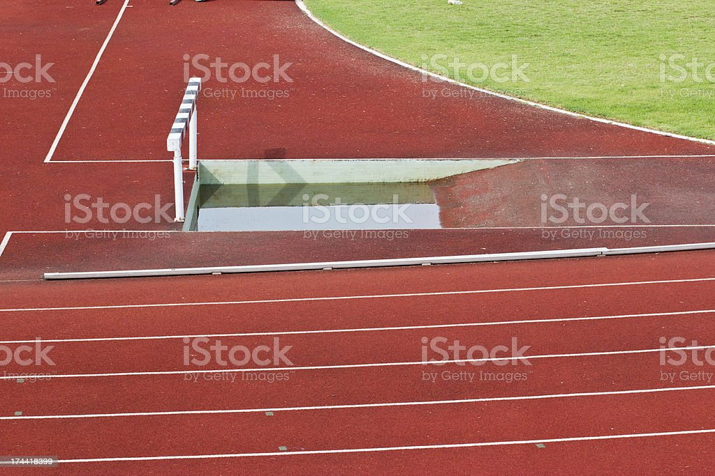 hurdles on the red running track prepared for competition. royalty-free stock photo