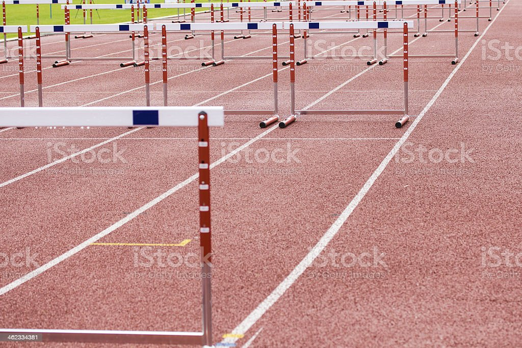 hurdles on the  running track stock photo