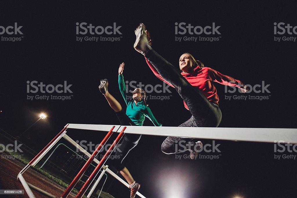Hurdling Young Athletes stock photo