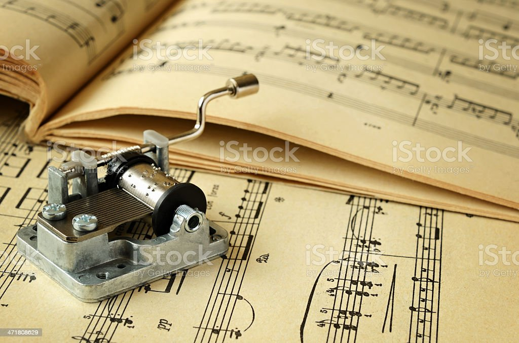 Hurdy-gurdy and music sheets royalty-free stock photo