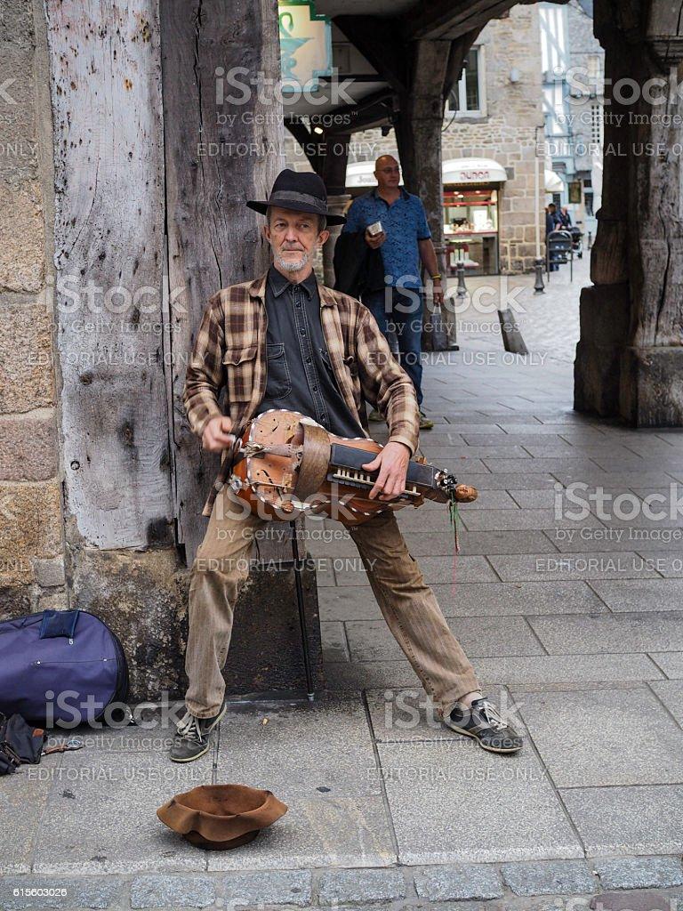 Hurdy-Gurdy Man, Dinan, France stock photo