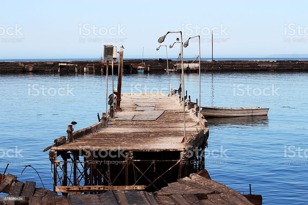 Hurricane aftermath: broken wooden dock stock photo