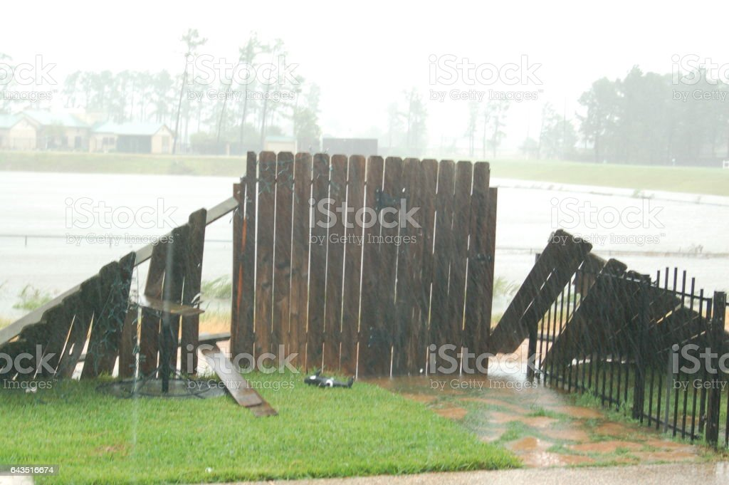 Hurricane damaged fence stock photo