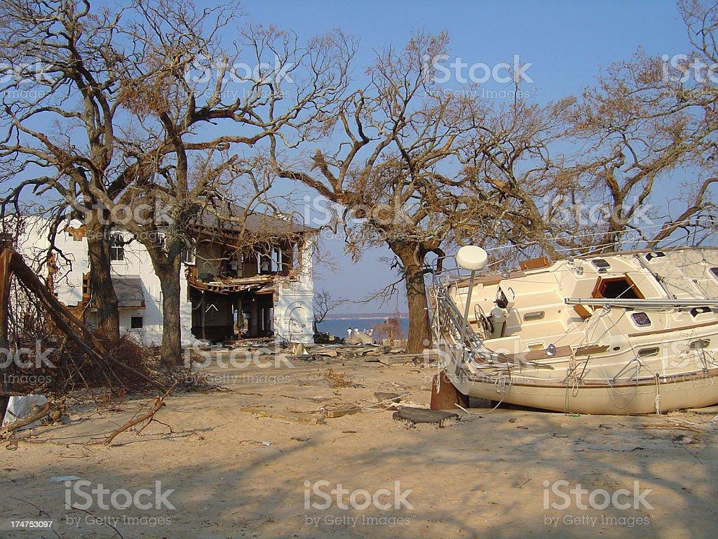 Hurricane Katrina Disaster with Sailboat Ashore and Demolished Home stock photo