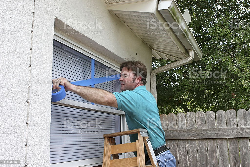 Hurricane Preparedness -Tape Windows stock photo