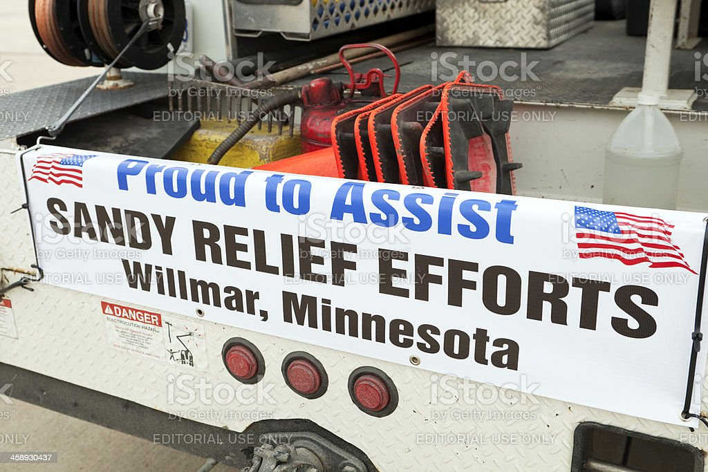 Hurricane Sandy Relief Banner on a Utility Truck royalty-free stock photo