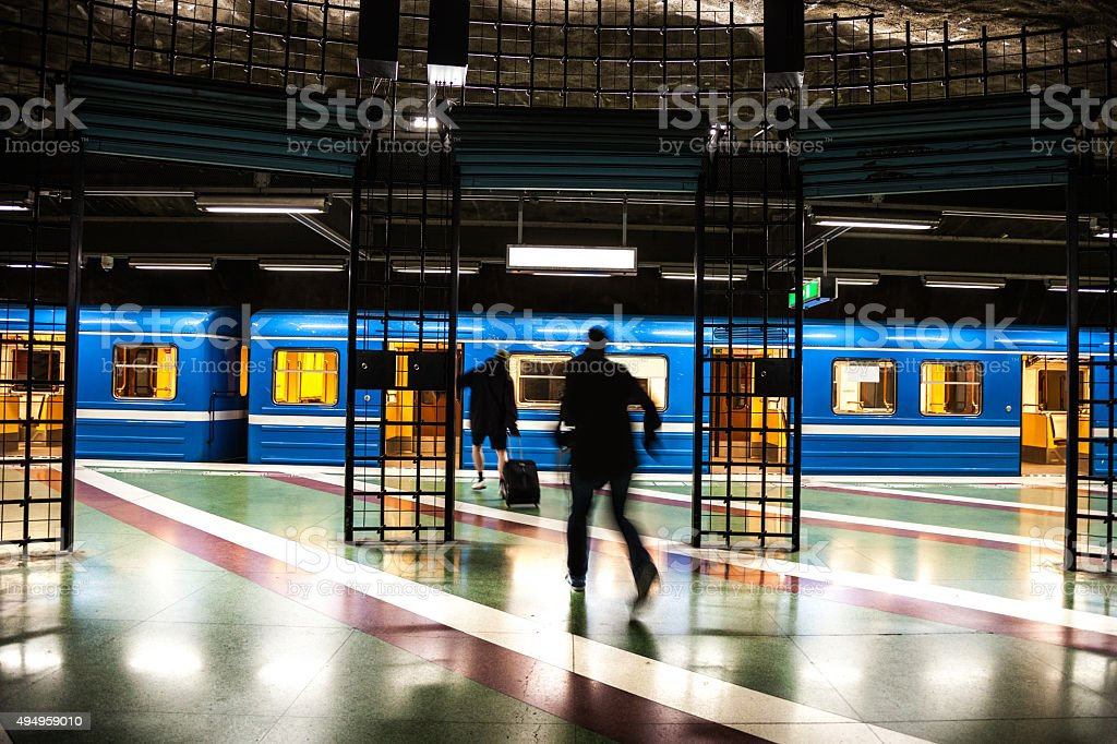 Hurry up! The train is leaving the platform! stock photo