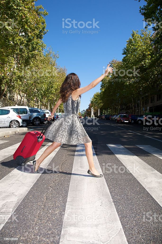 hurry up traveler woman suitcase calling taxi urban street royalty-free stock photo