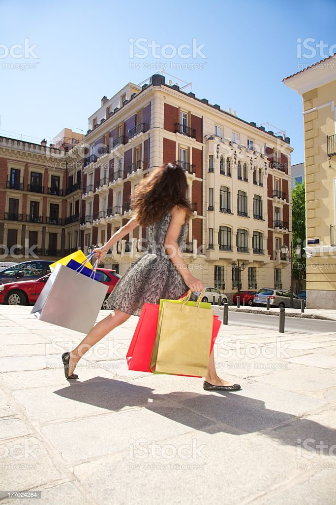 hurry up woman running with shopping bags stock photo
