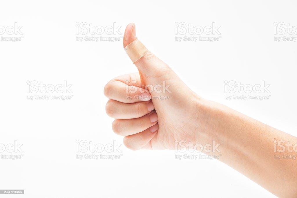 Hurt finger with a bandage isolated on white stock photo