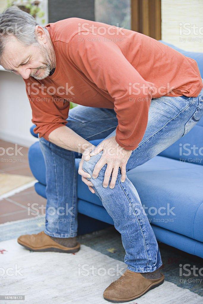 Hurting knee stock photo