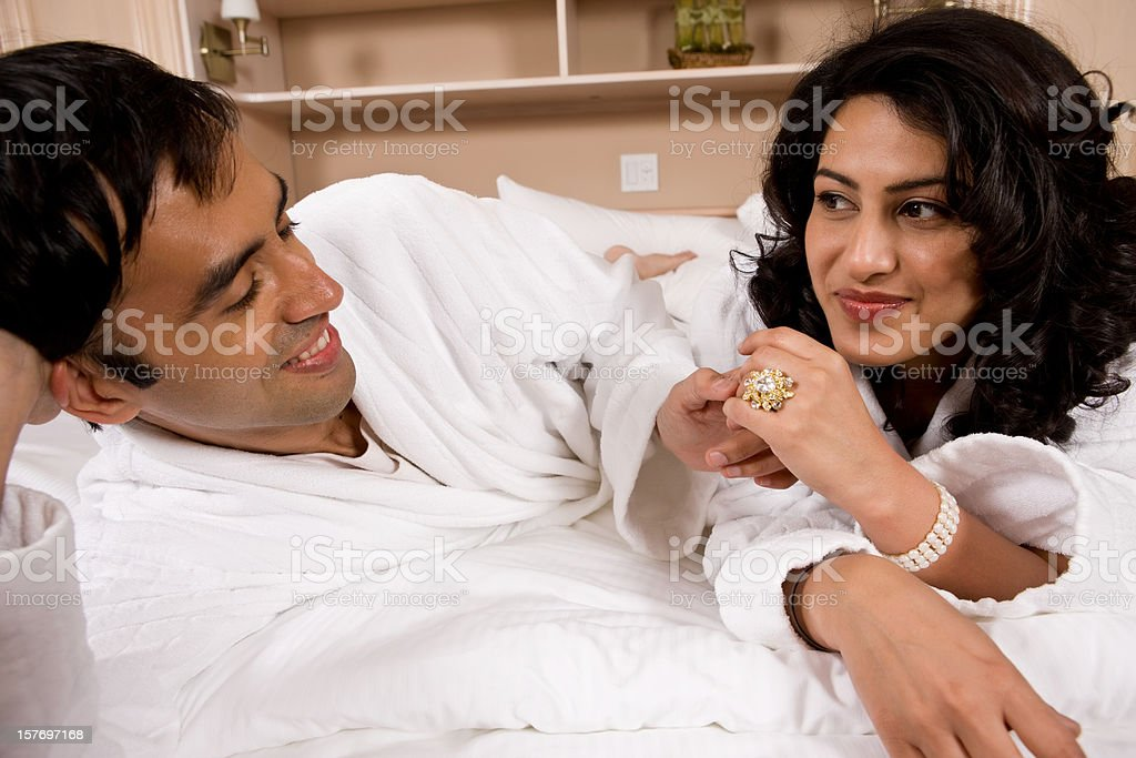 Husband Admires His Wife's New Ring royalty-free stock photo