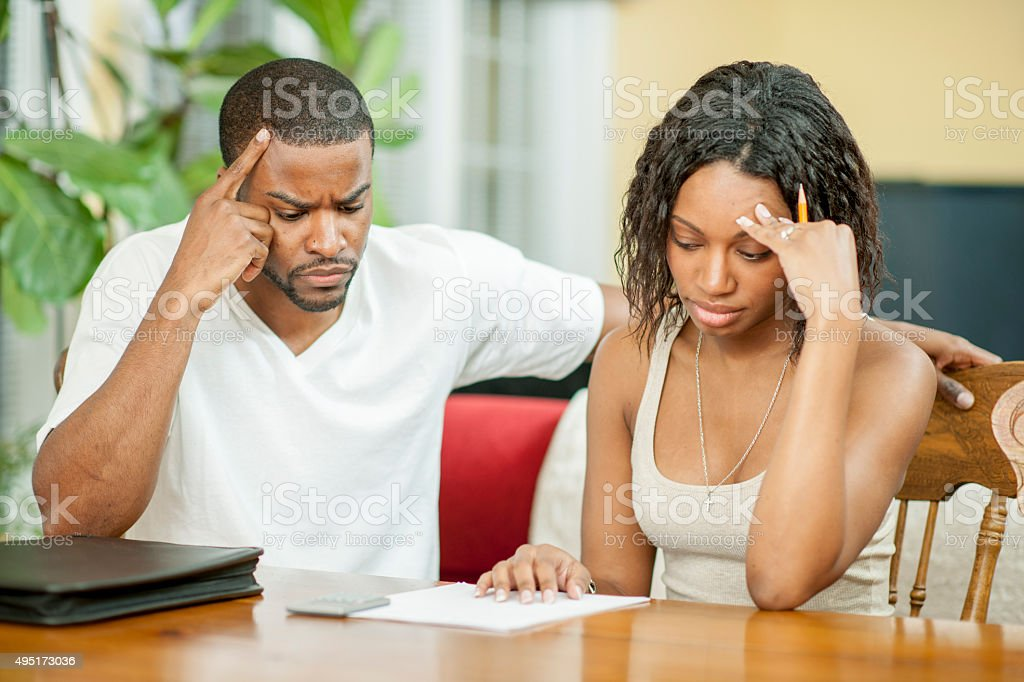 Husband and are Wife Frustrated with Their Budget stock photo