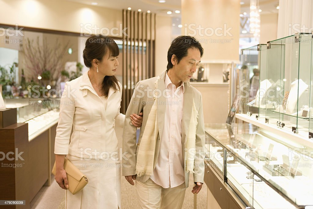 Husband and wife choosing accessories stock photo