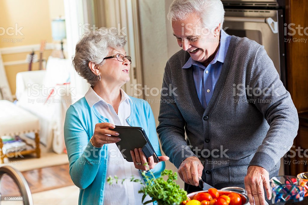 Husband and wife cook together stock photo