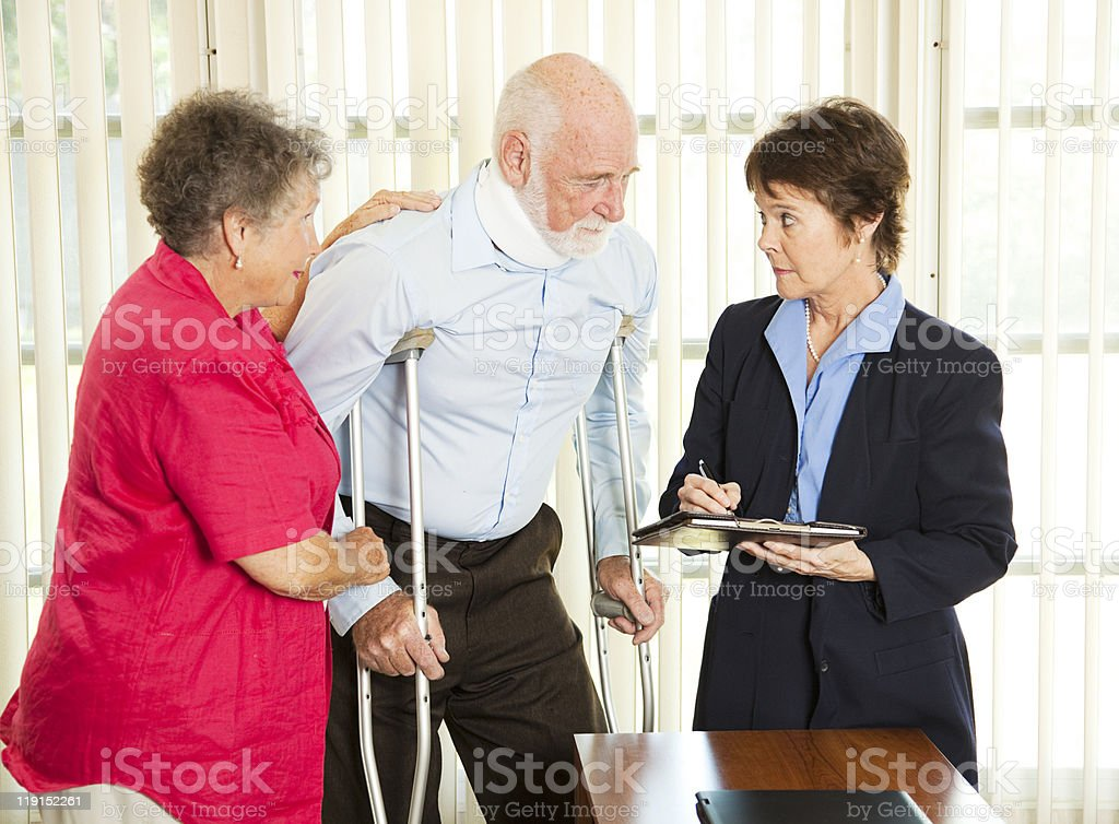 Husband and wife discussing personal injury with lawyer royalty-free stock photo
