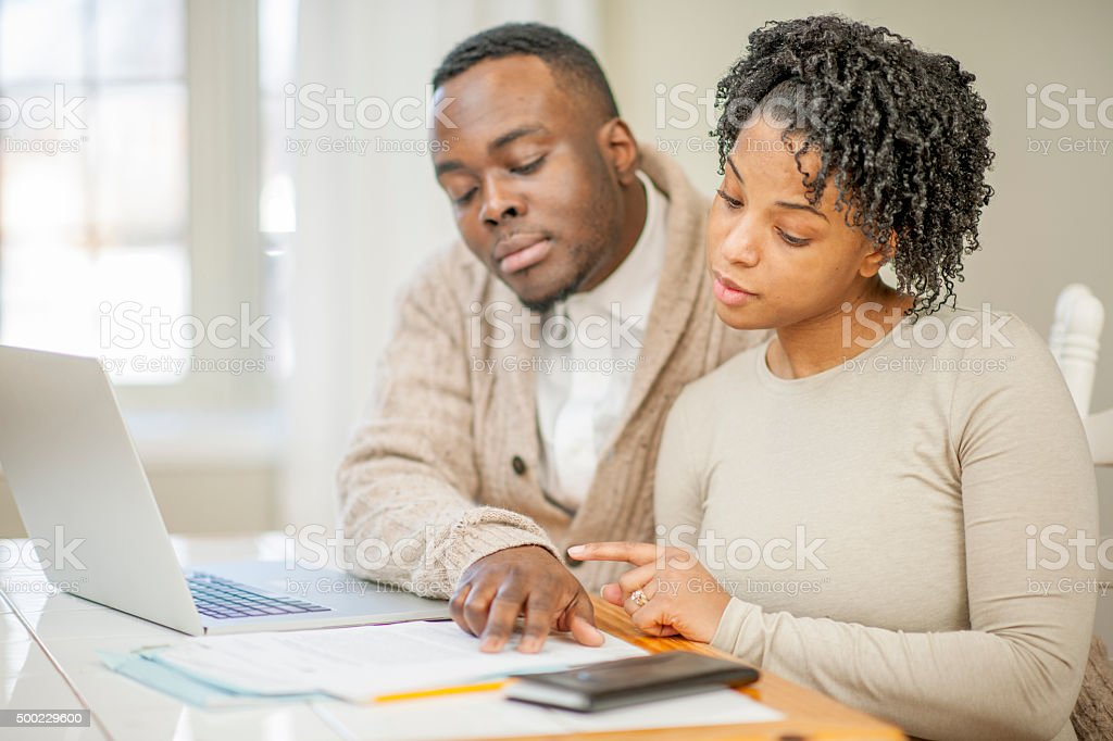Husband and Wife Doing Financial Planning stock photo