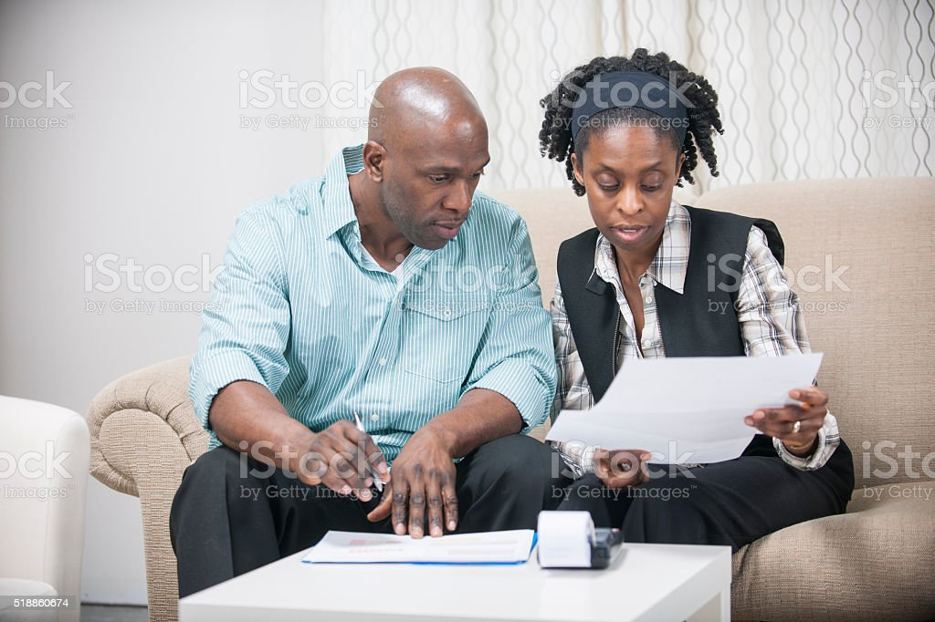Husband and Wife Going Over Their Personal Finances stock photo