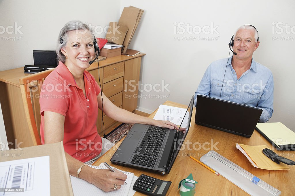 Husband and Wife Home Business Team Looking Up royalty-free stock photo