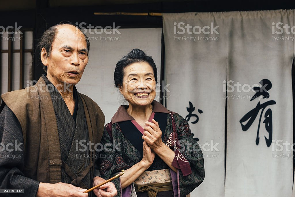 Husband And Wife In An Old Japanese Village stock photo