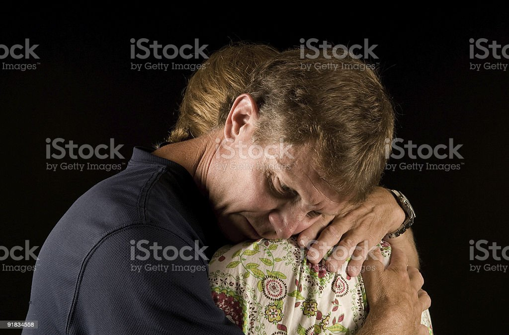 husband and wife in tearful hug royalty-free stock photo