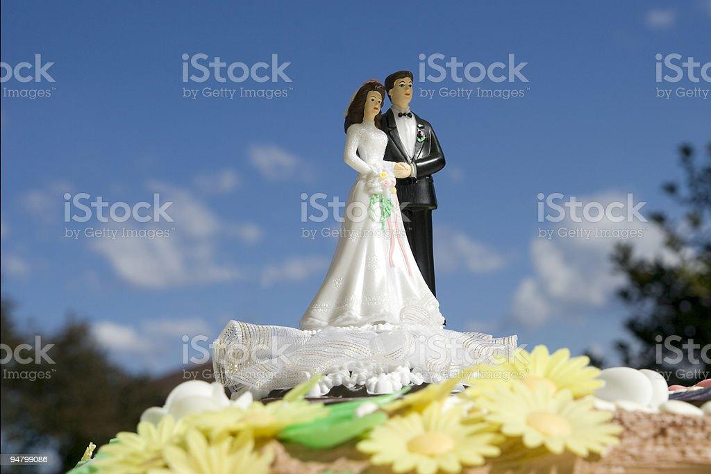 Husband and Wife on a Wedding Cake, Blue Sky stock photo