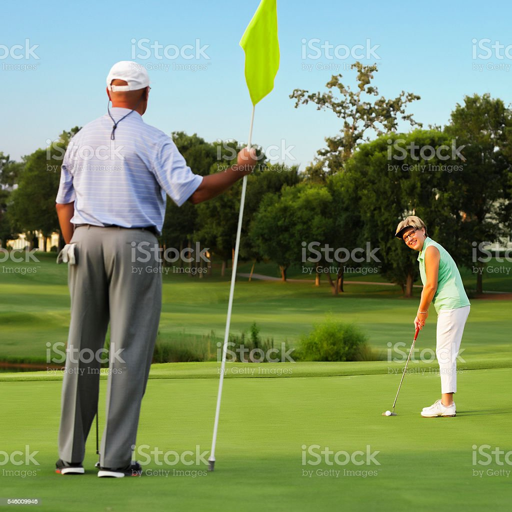 Husband and WIfe Playing Golf stock photo